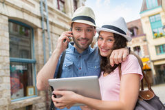 Young couple of tourists booking hostel Stock Images