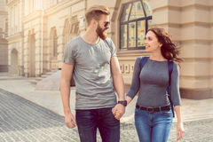 Young couple tourists city walk together vacation. Young couple women and men tourists city walk together vacation holding hands Royalty Free Stock Photo