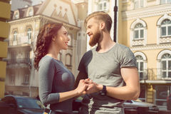 Young couple tourists city walk together vacation. Young couple women and men tourists city walk together vacation holding hands Stock Photos