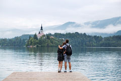 Young couple of tourists in love on the Lake Bled, Slovenia. Royalty Free Stock Photos