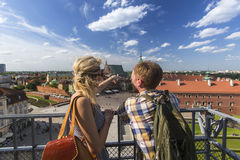 Young couple of tourists standing on the observation platform of the Castle Square in Warsaw. Royalty Free Stock Photos