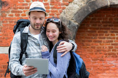 Young couple of tourists using tablet to visit city Stock Photo