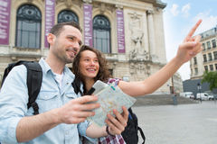 Young couple of tourists visiting city Royalty Free Stock Photo
