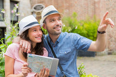 Young couple of tourists visiting city Stock Image