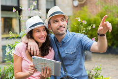 Young couple of tourists visiting city Stock Images