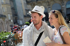 Young couple of tourists visiting town Stock Photo