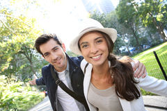Young couple of tourists walking in central park Stock Images