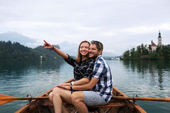 Young couple of tourists on wooden boat on the Lake Bled, Slovenia Stock Image