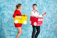 Young couple in a toy cars stock images