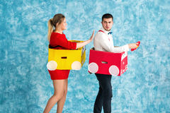 Young couple in a toy cars royalty free stock images