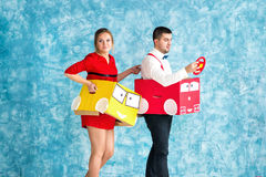 Young couple in a toy cars royalty free stock photo