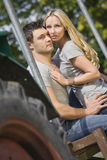 Young couple on tractor Royalty Free Stock Photo