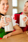 Young couple in traditional Bavarian Tracht in restaurant or pub Royalty Free Stock Photo
