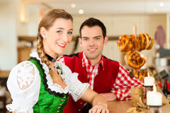 Young couple in traditional Bavarian Tracht in restaurant or pub Stock Photography