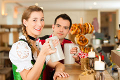 Young couple in traditional Bavarian Tracht in restaurant or pub Stock Photo