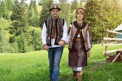 Couple in traditional ukrainian clothes in the Carpathians. Young couple in traditional ukrainian clothes in the Carpathian mountains near the house full of love royalty free stock photo