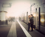 Young couple at train station Stock Image