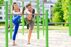 Young couple training outdoors Stock Images