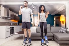 Young couple he trains with the step machine at home. In a modern apartment Royalty Free Stock Photo