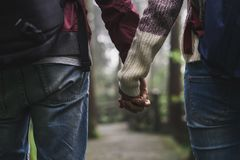 Young couple traveler with backpack holding hand together. In the forest Stock Images