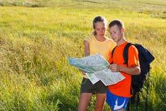 Young couple  traveler read the map Stock Photos