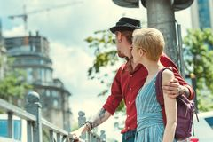 Young couple of travelers with backpacks hugging. In city royalty free stock photos