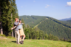 Young couple of travelers. Enjoying mountain view stock images