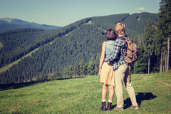 Young couple of travelers enjoying mountain view. Young couple of travelers enjoying alpine mountain view Royalty Free Stock Image