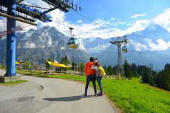 Young couple of travelers enjoying a mountains view in the summe Stock Photos