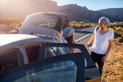 Young couple travelers having fun near the car Royalty Free Stock Image