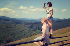 Young couple of travelers. Looking around mountain countryside summer view stock image