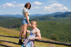 Young couple of travelers. Looking around mountain countryside summer view stock photo