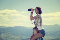 Young couple of travelers. Looking through binoculars royalty free stock photos