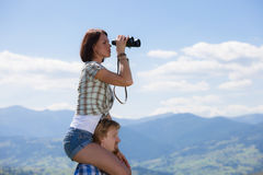Young couple of travelers. Looking through binoculars Royalty Free Stock Images