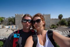 Young couple shot a selfie picture in front of a wall gate in Jerusalem royalty free stock photography