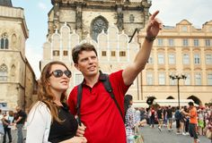Young couple travelers walking on a street of European city. sightseeing traveler. Prague, Old Town Square. Young couple travelers walking on a street of stock image