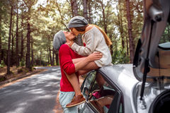 Young couple traveling by car in the forest Stock Image