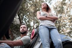 Young couple traveling by car makes a stop royalty free stock photography