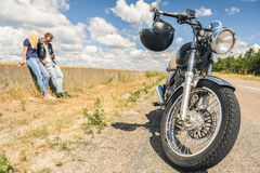 Young couple traveling by motorcycle Royalty Free Stock Images