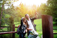 Young couple traveling in a nature. Happy people. Travel lifestyle Stock Images