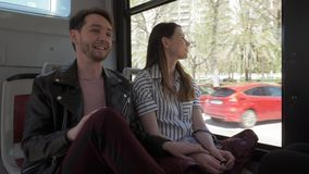 Storytelling in a bus. A young couple travelling by bus and communicating pleasantly stock video