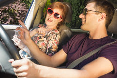 Young couple travelling by car Royalty Free Stock Photo
