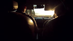 Young couple travelling in a car in the summer. stock video footage