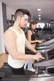 Young couple in treadmill Stock Photography