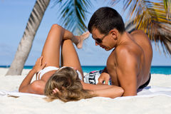 Young couple on a tropical beach Royalty Free Stock Photo
