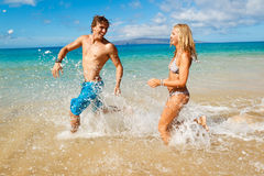Young Couple on Tropical Beach Royalty Free Stock Photos