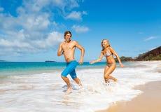 Young Couple on Tropical Beach Stock Photos