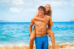 Young Couple on Tropical Beach Stock Image