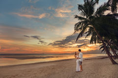 Young couple on the tropical beach Stock Image