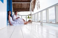 Young couple in tropical beach house Stock Photography